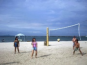 Tourist playing beach volleyball at Boracay beach.